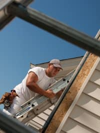 Danny's Pro employee David Martinez prepares a house in Carmel for painting. Photo by Lindy Keyser