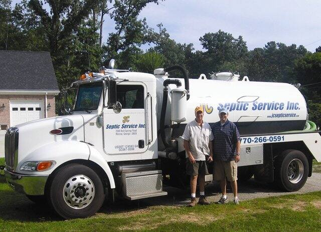 Photo by Kari Apted -  Jeff, left, and Jason Chambers are continuing a family tradition of septic service.