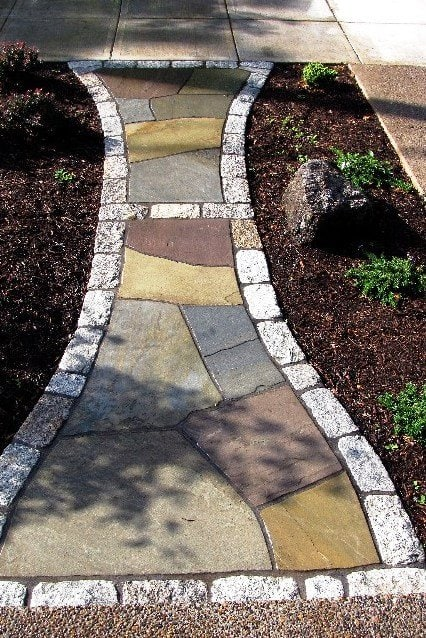 """""""We settled upon a colorful mix of Pennsylvania sandstone, accentuated with bands of reclaimed antique granite street cobbles."""" (Photo courtesy of Matt L. of Portland, Ore.)"""