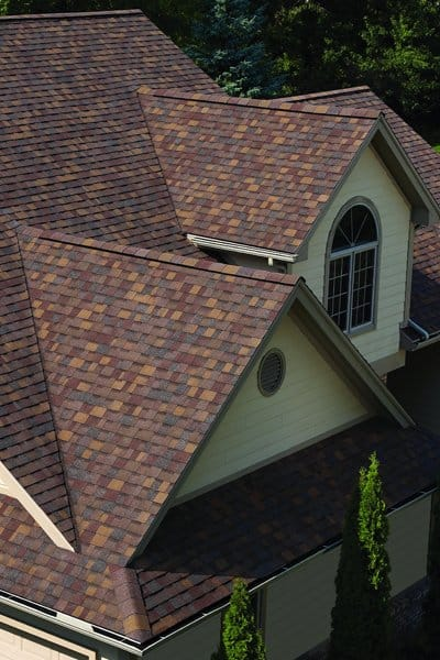 Choosing lighter roofing material and exterior colors can add fresh curb appeal and help improve your home's energy efficiency. (Photo courtesy of Arnold's Home Improvement)