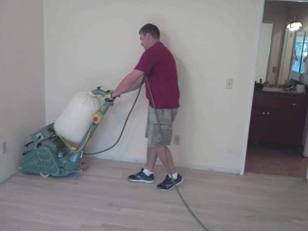 Angie's List members rave about refinishing work done by Bello Hardwood Flooring owner Doral Solovastru, who sands a floor with a belt sander during a recent job. (Photo courtesy of Doral Solovastru)