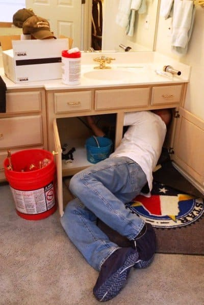 This member hired a plumber to install some high-end replacement master bathroom fixtures for his two sinks, shower and whirlpool bath. (Photo courtesy of Bill C. of Kerrville, Texas)