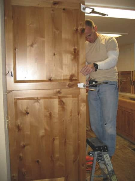 True Grain Woodworks owner Steve Medeiros installs custom cabinets and a pantry. He began working with wood in middle school. (Photo courtesy of Steve Medeiros)