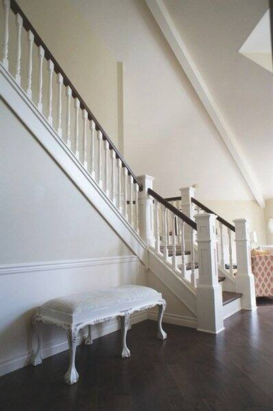 West Coast Stair Co. remodeled Hsueh's half-wall staircase, removing the drywall and installing new trim, newel posts, balusters and banisters. (Photo courtesy of Shanie Hsueh)