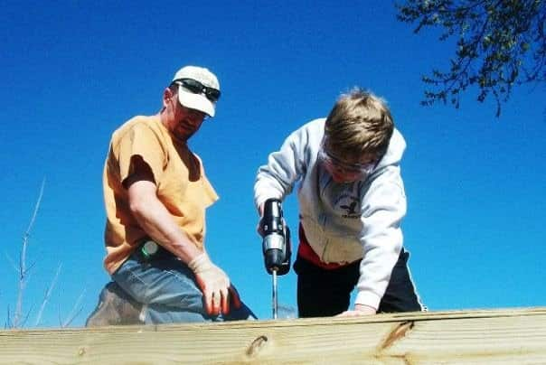 Shane Jenkins, left, oversees construction on a backyard project. The independent contractor has seen steady business in Edmond, Okla. (Photo courtesy of Shane's Handyman Service)