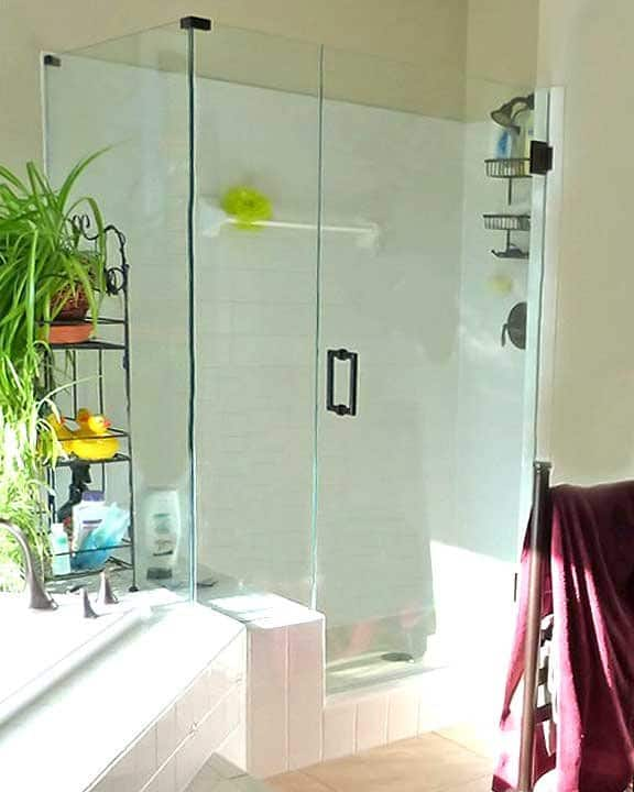bathroom remodel with glass shower enclosure