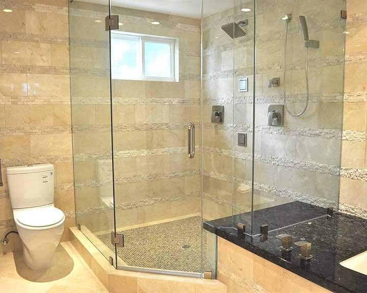 frameless glass shower with marble walls