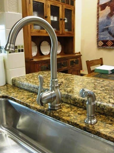 This member hired a highly rated plumber to replace an old double-basin with an new, stainless, single-basin kitchen sink with a new faucet and sprayer. (Photo courtesy of Angie's List member Kathy L. of Davie, Fla.)