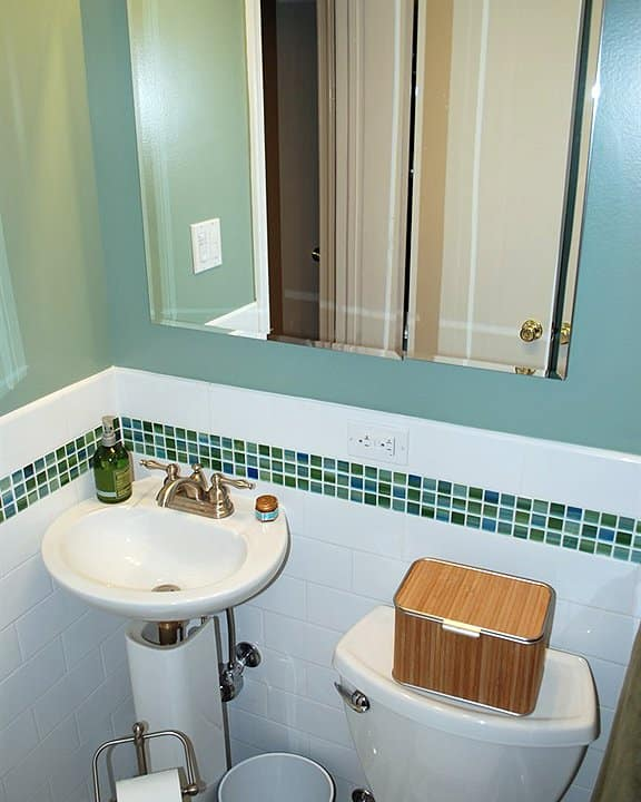 bathroom toilet and pedestal sink
