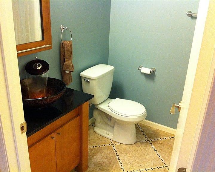 half-bathroom remodel with detail in tile floor