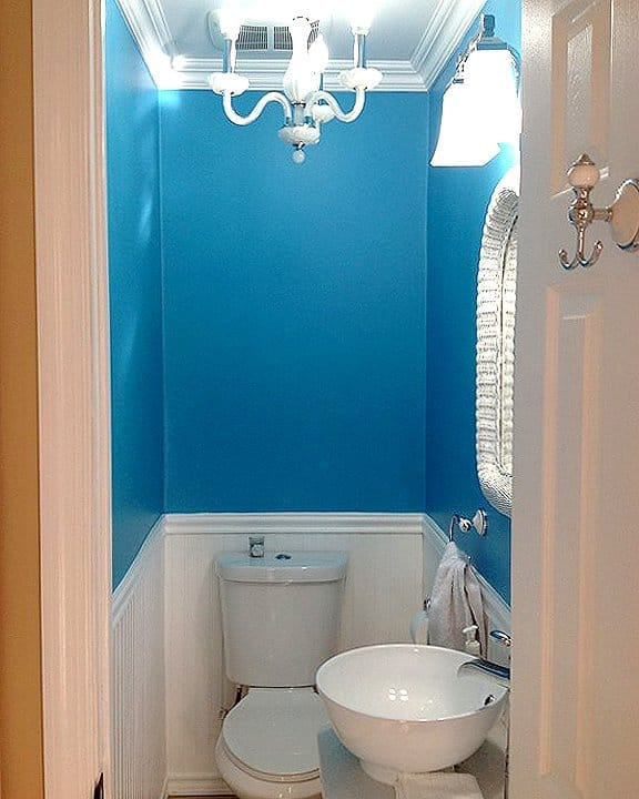 bathroom remodel with blue walls and wainscoting
