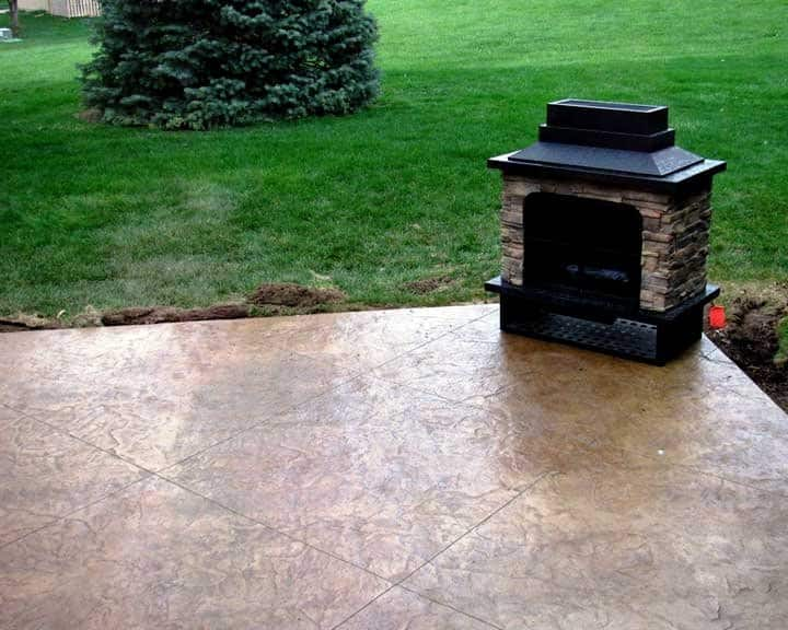 stamped concrete patio with outdoor fireplace
