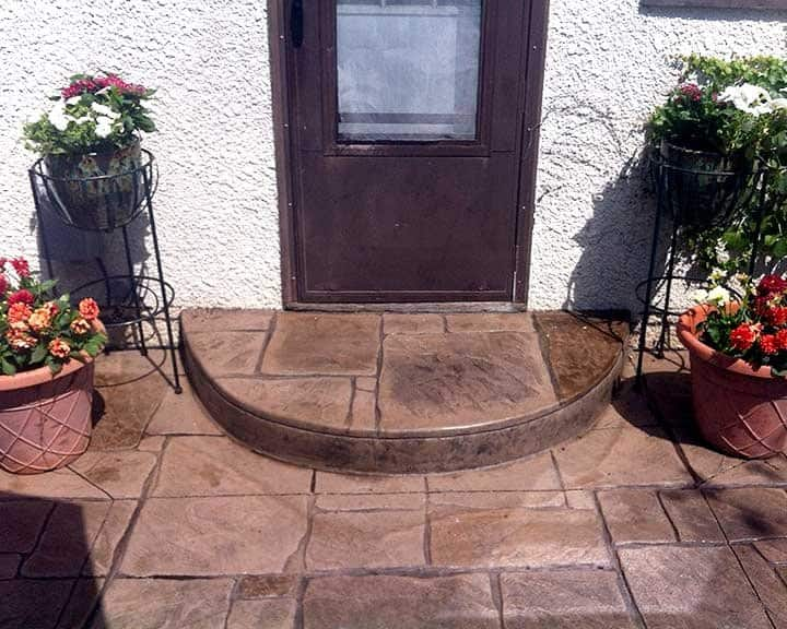 stamped concrete patio resembles english stone