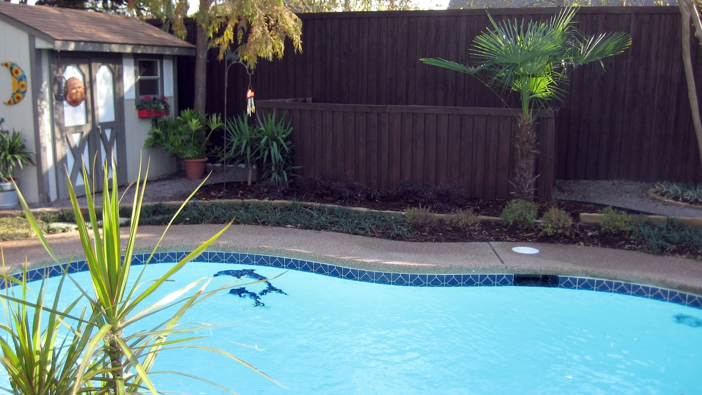 in-ground swimming pool with ceramic tile border
