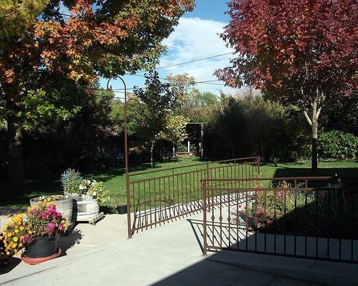 backyard with wrought iron railing
