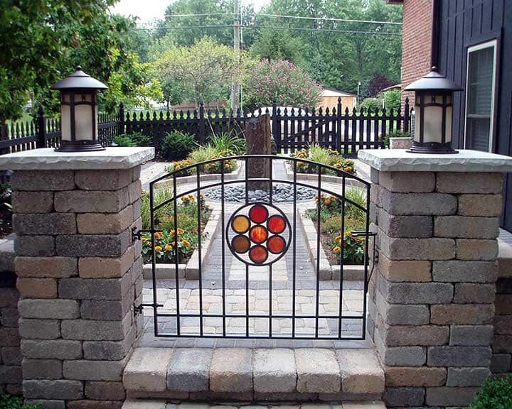 wrought iron gate with stained glass inlay