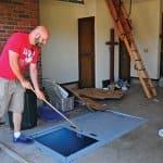homeowner shows an in-groun tornado shelter
