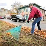 a man raking leaves in the fall in pendleton, indiana