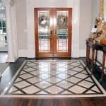 ceramic tile and hardwood floor in home entryway