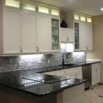 subway ceramic tile on backsplash wall in kitchen remodel