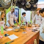 students at a cooking class preparing a meal