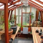 With a greenhouse at home, you can get sunlight in the winter while pruning your plants. (Photo courtesy of Angie's List member Loren S. of Portland)