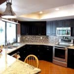 dark maple cabinets with granite countertop