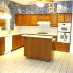 outdated kitchen with wallpaper