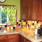 kitchen with colorful tile backsplash