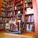 home library with floor-to-ceiling bookshelves
