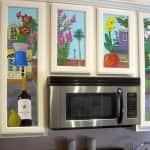 mural artwork on kitchen cabinets