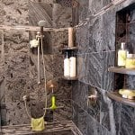 walk-in shower covered in slate