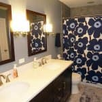 bathroom remodel with long vanity and tiled shower