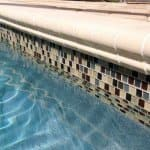 in-ground pool with glass tile border
