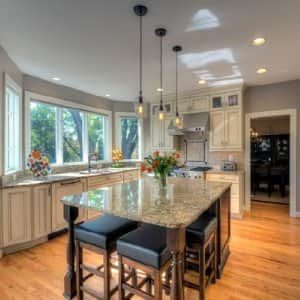 With the right seating, a kitchen island can serve as your kitchen table. Remove the chairs and it becomes a serving area for entertaining. (Photo by Moss Building & Design )