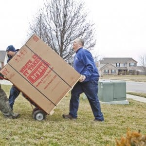 A/C installers hauling box