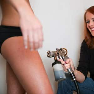 Salon owner Liz Medley says she and her staff try to talk during the tan to make their clients feel at ease. (Photo by Brandon Smith)
