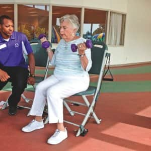 Indianapolis member Roxy Dodson, 76, works out with personal trainer Andre Grimes to help improve her strength and flexibility. (Photo by Brandon Smith)
