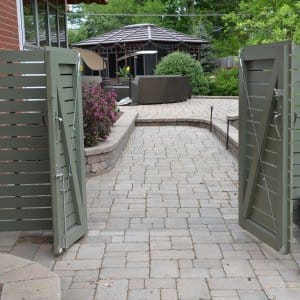 Paver Walkway Through Gate To Backyard Patio. (Photo By Photo By Roger  Tunis )