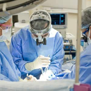 Dr. Michael Coscia performs spinal surgery on a patient at OrthoIndy on the Northwest side. (Photo by Brandon Smith)