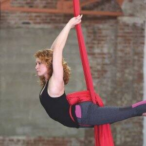 Mary Brumbaugh, owner of CirqueIndy, uses double ribbon fabric to demonstrate to her beginner class, some of the poses in aerial circus arts. (Photo by Steve C. Mitchell)