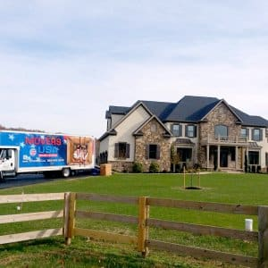 moving truck by house