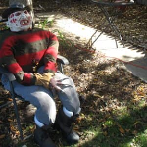 """I made this Freddy Krueger dummy by stuffing last year's Halloween costume with leaves. It didn't cost a penny, and it makes me flinch every time I walk outside."" – Mike LaFollette"