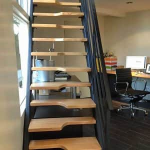 Steeply angled alternating stairs provided a space-saving solution to adding a second-floor room to this small space. (Photo courtesy of Angie's List member Sarah Fix)