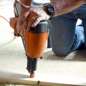 Contractor drilling into wood.