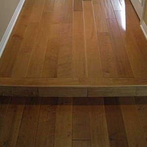 Distressed wood flooring adds warmth to a home and can reduce the impact of later wear and tear. (Photo courtesy of Angie's List member Traci B.)