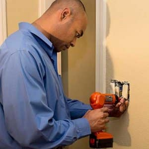 electrician working on light switch