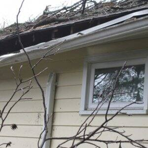 Angie's List member Christine W. submitted this photo showing roof damage caused by Hurricane Sandy.