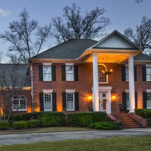 Columns on a front porch, dogwood trees, Japanese maple trees and natural stone facades are among the most beautiful features to illuminate, says Wallace. (Photo courtesy of LawnWorks)