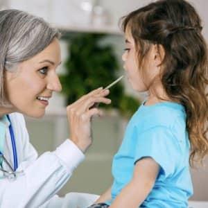 pediatrician examining a young girl